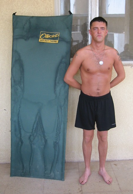 I've heard of people trying to fill others boots but Nev here has taken things a little too far. He poses next to a sunbed as used by Sean the 'God lof love',  to top up his tan, check out the sweat marks! (Sean was too shy to pose in the piccie himself so Nev took his place.)