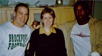 Rheinfire footballer's Jason Johnson and Derrick Ham together with BFBS listener Ireen Young...