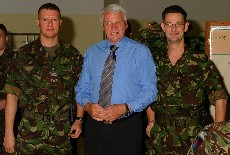 WO2 Jim Sutherland pictured with Sir Bobby Robson and Cpl Glen Gittings. Taken when Newcastle United visited Butmir Camp, Sarajevo. [August 2002]